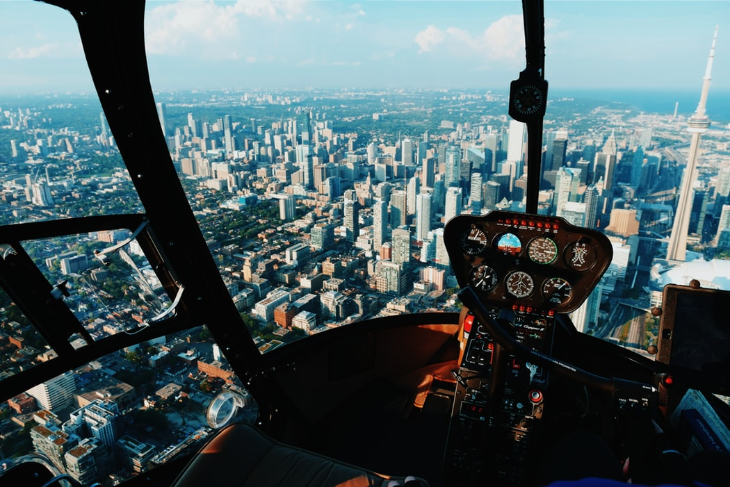 helicopter-flying-over-city