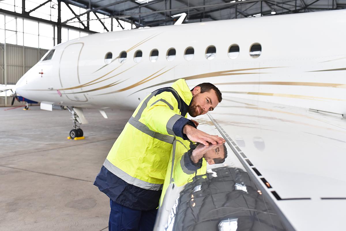 Man examining jet